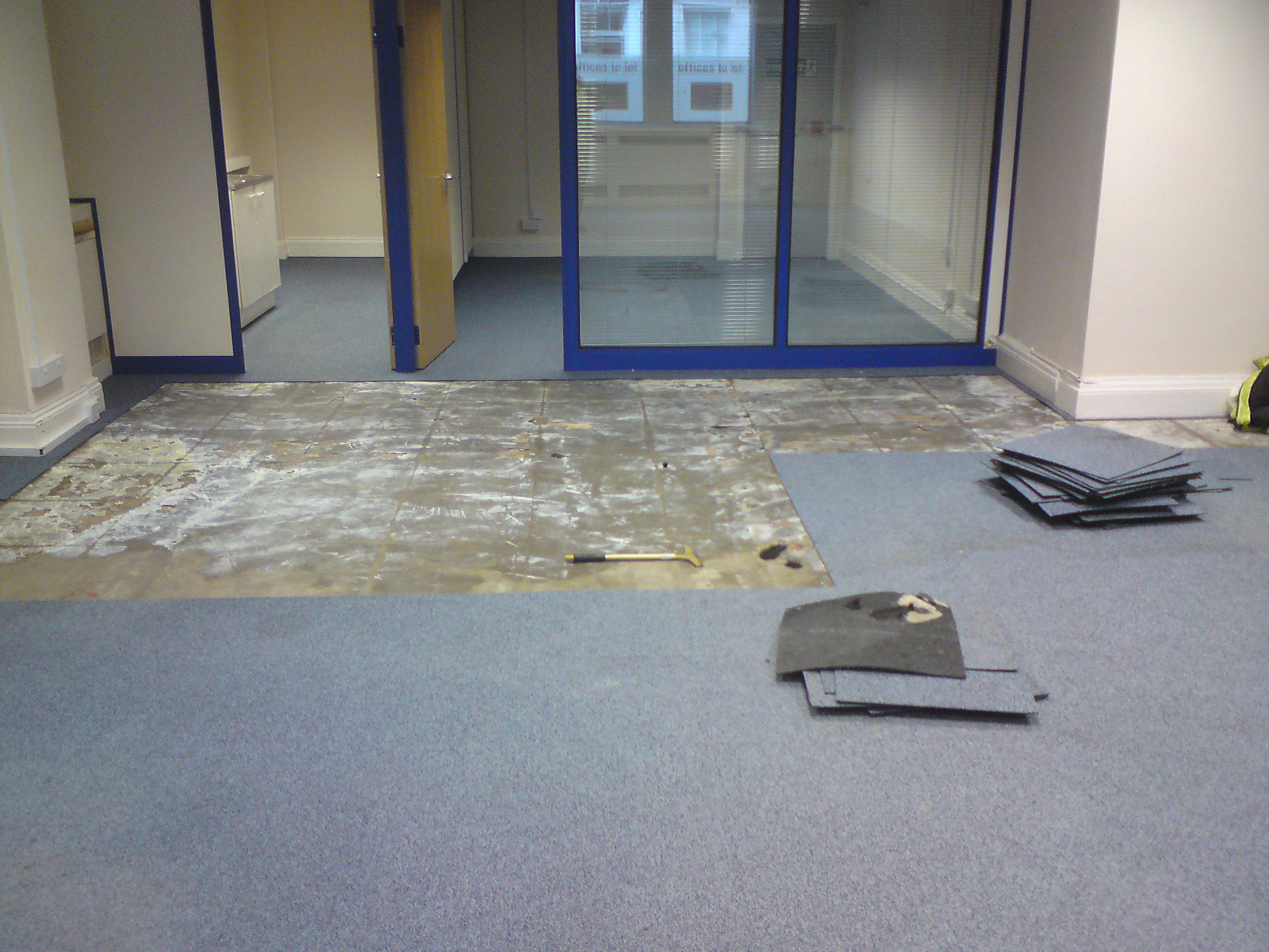 job we had to removing wet carpet tile from an office in the central